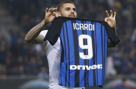 Inter Milan's Mauro Icardi shows his jersey to fans as he celebrates after scoring his side's 3rd goal during the Serie A soccer match between Inter Milan and AC Milan, at the Milan San Siro Stadium, Italy, Sunday, Oct. 15, 2017. (AP Photo/Antonio Calanni)