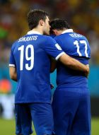 RECIFE, BRAZIL - JUNE 29:  Theofanis Gekas of Greece is consoled by Sokratis Papastathopoulos after being defeated in a penalty shootout during the 2014 FIFA World Cup Brazil Round of 16 match between Costa Rica and Greece at Arena Pernambuco on June 29, 2014 in Recife, Brazil.  (Photo by Paul Gilham/Getty Images)