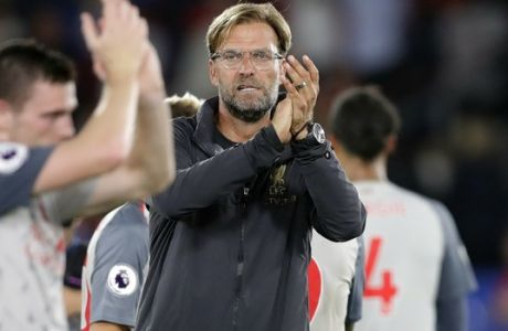 Liverpool's manager Juergen Klopp, center, applauds to supporters at the end of the English Premier League soccer match between Crystal Palace and Liverpool at Selhurst Park stadium in London, Monday, Aug. 20, 2018. (AP Photo/Kirsty Wigglesworth)