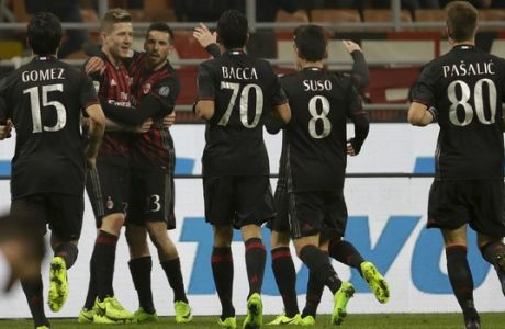 AC Milan's Juraj Kucka, second from left, celebrates with teammates after scoring during a Serie A soccer match between AC Milan and Fiorentina, at the San Siro stadium in Milan, Italy, Sunday, Feb. 19, 2017. (AP Photo/Antonio Calanni)