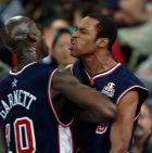 United States' Vince Carter, right, and Kevin Garnett celebrate following Carter's dunk in the second half of their game at the Dome during the 2000 Summer Olympics in Sydney, Monday, Sept. 25, 2000.  USA defeated France 106-94. (AP Photo/Roberto Borea)