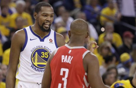 Golden State Warriors forward Kevin Durant (35) looks toward Houston Rockets guard Chris Paul (3) during the second half of Game 3 of the NBA basketball Western Conference Finals in Oakland, Calif., Sunday, May 20, 2018. (AP Photo/Marcio Jose Sanchez)