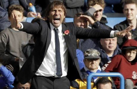Chelsea head coach Antonio Conte reacts during the English Premier League soccer match between Chelsea and Watford at Stamford Bridge stadium in London, Saturday, Oct. 21, 2017. (AP Photo/Matt Dunham)