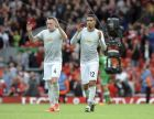 Manchester United's Phil Jones, left, and Manchester United's Chris Smalling applause he audience after during the English Premier League soccer match between Liverpool and Manchester United at Anfield, Liverpool, England, Saturday, Oct. 14, 2017. (AP Photo/Rui Vieira)