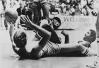 """Indiana State's Larry Bird, left, lies on his back to toss the ball during a scramble with Earvin """"Magic"""" Johnson, right, during NCAA Championship game in Salt Lake City, Utah, March 26, 1979. (AP Photo)"""