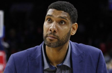 FILE - In this Dec. 7, 2015, file photo, San Antonio Spurs' Tim Duncan watches the second half of an NBA basketball game against the Philadelphia 76ers, in Philadelphia. Duncan announced his retirement on Monday, July 11, 2016, after 19 seasons, five championships, two MVP awards and 15 All-Star appearances. It marks the end of an era for the Spurs and the NBA.  (AP Photo/Chris Szagola, FIle)