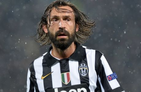 Juventus' Andrea Pirlo scorer of his team's goal is seen during a Champions League, Group A soccer match between Juventus and Olympiakos, at the Juventus Stadium in Turin, Italy, Tuesday, Nov. 4, 2014. Pirlo scored on his 100th Champions League appearance. (AP Photo/Massimo Pinca)