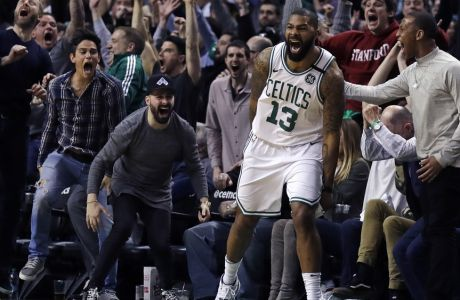 Boston Celtics forward Marcus Morris (13) and fans celebrate his game-winning 3-point shot in the team's NBA basketball game against the Oklahoma City Thunder in Boston, Tuesday, March 20, 2018. The Celtics defeated the Thunder 100-99. (AP Photo/Charles Krupa)