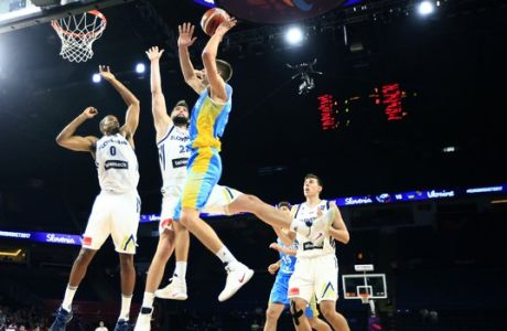 Ukraine's Denys Lukashov, right, jumps to score a basket as Slovenia's Anthony Randolph, left, and Ziga Dimec trie to stop him during their Eurobasket European Basketball Championship round of 16 match in Istanbul, Saturday, Sept. 9. 2017. (AP Photo/Lefteris Pitarakis)