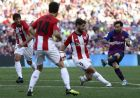 FC Barcelona's Lionel Messi, right, kicks the ball during the Spanish La Liga soccer match between FC Barcelona and Athletic Bilbao at the Camp Nou stadium in Barcelona, Spain, Saturday, Sept. 29, 2018. (AP Photo/Manu Fernandez)