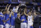 Duke players raise the trophy after defeating Florida State in the NCAA college basketball championship game of the Atlantic Coast Conference tournament in Charlotte, N.C., Saturday, March 16, 2019. (AP Photo/Chuck Burton)