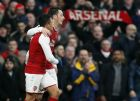 Arsenal's Alexis Sanchez, left celebrates his goal with Arsenal's Mesut Ozil during the English Premier League soccer match between Arsenal and Tottenham Hotspur at Emirates stadium in London, Saturday, Nov. 18, 2017. (AP Photo/Kirsty Wigglesworth)
