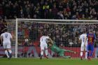 Barcelona's Lionel Messi scores a penalty past PSG goalkeeper Kevin Trapp during the Champions League round of 16, second leg soccer match between FC Barcelona and Paris Saint Germain at the Camp Nou stadium in Barcelona, Spain, Wednesday March 8, 2017. (AP Photo/Manu Fernandez)