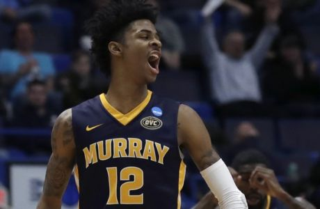 Murray State's Ja Morant (12) celebrates with Shaq Buchanan (11) during the second half of a first round men's college basketball game against Marquette in the NCAA Tournament, Thursday, March 21, 2019, in Hartford, Conn. (AP Photo/Elise Amendola)