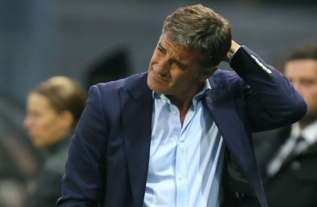 Marseille's new coach, Michel, grimaces near the pitch during his French League One soccer match against Guingamp at the Roudourou stadium in Guingamp, western France, Friday, Aug. 28, 2015. Spanish coach Jose Miguel Gonzalez del Campo, known as Michel, has been appointed by Marseille as the successor to Marcelo Bielsa. Guingamp defeated Marseille 2-0. (AP Photo/David Vincent)