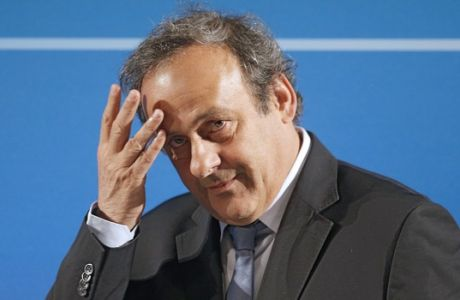 FILE - In this Feb.22, 2014 file photo, UEFA President Michel Platini arrives at a press conference, one day prior to the UEFA EURO 2016 qualifying draw in Nice, southeastern France. Platini will be allowed to address European soccer leaders before his successor as UEFA president is elected, despite serving a four-year ban from the sport.  UEFA's eagerness to ensure Platini can deliver a speech in Athens on Wednesday, Sept. 14, 2016 is in keeping with how the body has stood by the disgraced Frenchman since he was first suspended in November. No interim leader was installed as Platini was allowed to exhaust all legal routes in an attempt to overturn his ban over a payment of 2 million Swiss francs ($2 million) from FIFA in 2011.  (AP Photo/Lionel Cironneau, File)