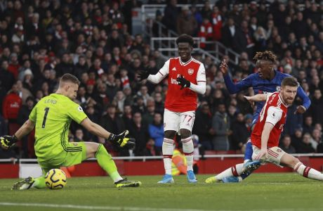 Chelsea's Tammy Abraham scores his side's second goal during the English Premier League soccer match between Arsenal and Chelsea, at the Emirates Stadium in London, Sunday, Dec. 29, 2019. (AP Photo/Ian Walton)