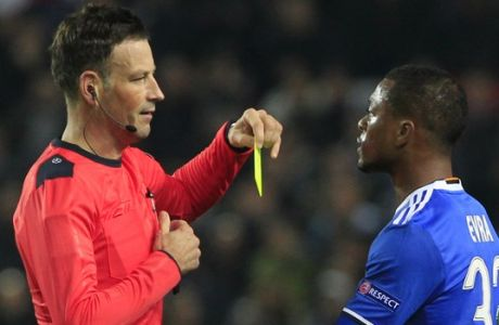Referee Mark Clattenburg of Britain shows a yellow card to Juventus' Patrice Evra during the Group H Champions League soccer match between Sevilla and Juventus at the Ramon Sanchez-Pizjuan stadium in Seville, Spain, Tuesday Nov. 22, 2016. (AP Photo/Miguel Morenatti)