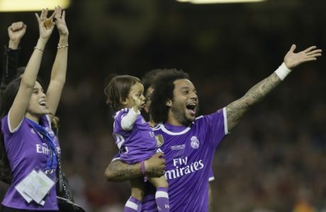 Real Madrid's Marcelo celebrates with his family after the Champions League final soccer match between Juventus and Real Madrid at the Millennium Stadium in Cardiff, Wales, Saturday June 3, 2017. Real won 4-1. (AP Photo/Tim Ireland)