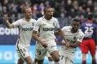 Monaco's Kylian Mbappe, center, celebrates with teammates after he scored the first goal during their French League One soccer match against Caen, in Caen, north western France, Sunday, March 19, 2017. (AP Photo/David Vincent)