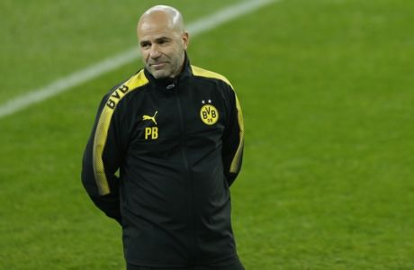 Borussia Dortmund head coach Peter Bosz smiles during a training session at the Santiago Bernabeu stadium in Madrid, Tuesday, Dec. 5, 2017. Borussia Dortmund will play a Champions League group H soccer match against Real Madrid on Wednesday 6. (AP Photo/Francisco Seco)