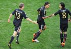 Germany's midfielder Thomas Mueller (L) celebarets with Sami Khedira (C) and Mesut Ozil after scoring during the 2010 World Cup quarter final Argentina vs Germany on July 3, 2010 at Green Point stadium in Cape Town. NO PUSH TO MOBILE / MOBILE USE SOLELY WITHIN EDITORIAL ARTICLE -       AFP PHOTO / CHRISTOPHE SIMON (Photo credit should read CHRISTOPHE SIMON/AFP/Getty Images)