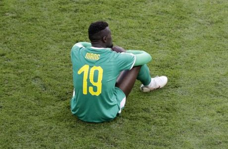 Senegal's Mbaye Niang sits on the pitch at the end of the group H match between Senegal and Colombia, at the 2018 soccer World Cup in the Samara Arena in Samara, Russia, Thursday, June 28, 2018. (AP Photo/Gregorio Borgia)