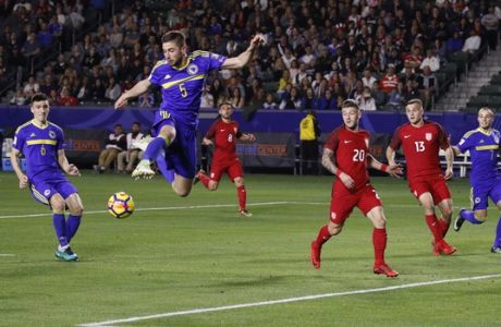 Bosnia and Herzegovina defender Marko Mihojevic(5) kicks the ball away during the second half of an international friendly soccer match against the United States Sunday, Jan. 28, 2018, in Carson, Calif. The game ended in a 0-0 draw. (AP Photo/Jae C. Hong)