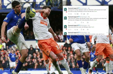Everton's Denis Stracqualursi, left, vies for the ball against Blackpool's Danny Wilson, second left, during their English FA Cup fifth round soccer match at Goodison Park, Liverpool, England, Saturday Feb. 18, 2012. (AP Photo/Tim Hales)
