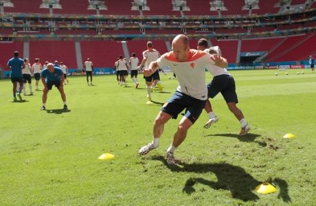 """Netherland's forward Arjen Robben exercises during a training session at the Estadio Nacional in Brasilia, Brazil, Friday, July 11, 2014. Dutch squad plays Saturday's third-place match against host Brazil. """"They can keep it,""""  Robben said of the third-place game. """"Only one prize counts and that is becoming world champion.""""(AP Photo/Eraldo Peres)"""