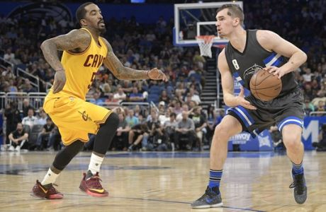 Orlando Magic guard Mario Hezonja (8) pulls up in front of Cleveland Cavaliers guard J.R. Smith (5) during the second half of an NBA basketball game in Orlando, Fla., Saturday, March 11, 2017. The Cavaliers won 116-104. (AP Photo/Phelan M. Ebenhack)