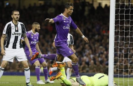 Real Madrid's Cristiano Ronaldo scores during the Champions League final soccer match between Juventus and Real Madrid at the Millennium Stadium in Cardiff, Wales, Saturday June 3, 2017. (AP Photo/Kirsty Wigglesworth)