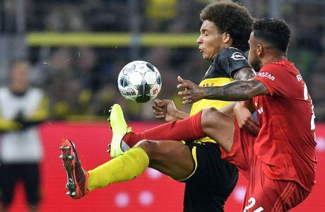 Ο Βιτσέλ της Ντόρτμουντ και ο Τολισό της Μπάγερν διεκδικούν την μπάλα στο γερμανικό Supercup, που διεξήχθη στις 3 Αυγούστου 2019 (AP Photo/Martin Meissner)
