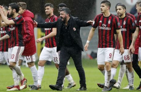 AC Milan coach Gennaro Gattuso celebrates with his players after winning the Serie A soccer match between AC Milan and Chievo Verona at the San Siro stadium in Milan, Italy, Sunday, March 18, 2018. (AP Photo/Antonio Calanni)