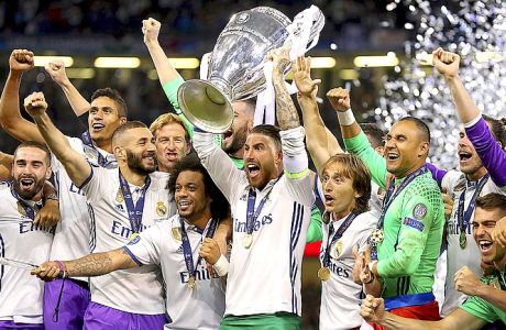Real Madrid's captain Sergio Ramos raises the trophy after the Champions League Final soccer match between Juventus and Real Madrid at the Millennium Stadium in Cardiff, Wales, Saturday, June 3, 2017. (Nick Potts/PA via AP)