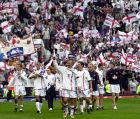 England's captain David Beckham, center, celebrates with his team after qualifying for the World Cup finals after their soccer match against Greece at Manchester's Old Trafford Ground Saturday, Oct. 6, 2001. England drew 2-2 with Greece. Beckham scored the team's second goal. (AP Photo/Adam Butler)