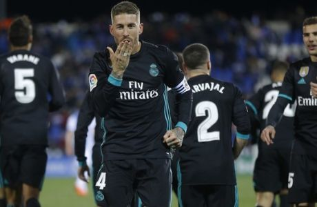 Real Madrid's Sergio Ramos blows a kiss as he celebrates after scoring his side's third goal during a Spanish La Liga soccer match between Real Madrid and Leganes at the Butarque stadium in Leganes, outside Madrid, Wednesday, Feb. 21, 2018. Real Madrid won 3-1.  (AP Photo/Francisco Seco)