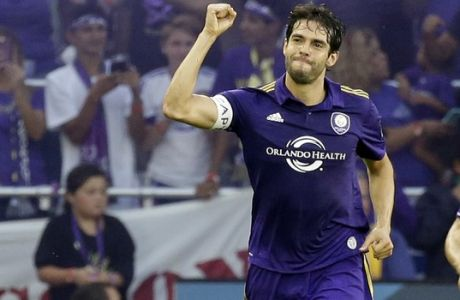Orlando City's Kaka, left, celebrates his goal against Sporting Kansas City during the first half of an MLS soccer game, Saturday, May 13, 2017, in Orlando, Fla. (AP Photo/John Raoux)