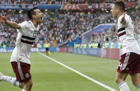 Mexico's Javier Hernandez, right, celebrates with teammate Hirving Lozano after scoring his side's second goal during the group F match between Mexico and South Korea at the 2018 soccer World Cup in the Rostov Arena in Rostov-on-Don, Russia, Saturday, June 23, 2018. (AP Photo/Lee Jin-man)