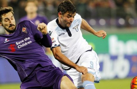 Fiorentina's Davide Astori, left, is challenged by Lazio's Filip Djordjevic during a Serie A soccer match at the Artemio Franchi stadium in Florence, Italy, Saturday, Jan. 9, 2016. (AP Photo/Fabrizio Giovannozzi)