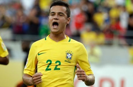 Brazil's Philippe Coutinho (22) celebrates after scoring a gaol against Haiti during the first half of a Copa America group B soccer match at Camping World Stadium, Wednesday, June 8, 2016, in Orlando, Fla. (AP Photo/John Raoux)