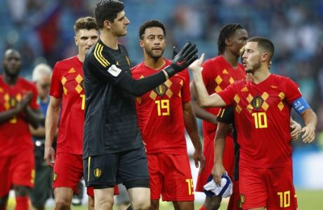 Belgium goalkeeper Thibaut Courtois shakes hands with Belgium's Eden Hazard after winning the group G match between Belgium and Panama at the 2018 soccer World Cup in the Fisht Stadium in Sochi, Russia, Monday, June 18, 2018. (AP Photo/Matthias Schrader)