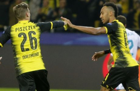 Dortmund's Lukasz Piszczek, left, congratulates Pierre-Emerick Aubameyang who scored his side's first goal during a Champions League Group H soccer match between Borussia Dortmund and Real Madrid at the BVB stadium in Dortmund, Germany, Tuesday, Sept. 26, 2017. (AP Photo/Michael Probst)
