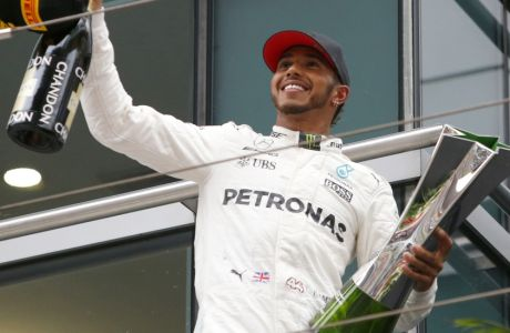 Mercedes driver Lewis Hamilton of Britain acknowledges cheering of spectators before leaving the podium after winning the Chinese Formula One Grand Prix at the Shanghai International Circuit in Shanghai, China, Sunday, April 9, 2017. (AP Photo/Toru Takahashi)