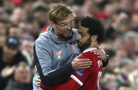 Liverpool coach Jurgen Klopp hugs Liverpool's Mohamed Salah after he was substituted during the Champions League semifinal, first leg, soccer match between Liverpool and AS Roma at Anfield Stadium, Liverpool, England, Tuesday, April 24, 2018. (AP Photo/Dave Thompson)