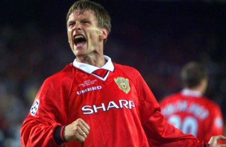 ** FILE ** Manchester United's Teddy Sheringham celebrates after scoring the equaliser during the UEFA Champions Cup final soccer match at the Nou Camp Stadium in Barcelona in this Wednesday May 26, 1999 file photo. Former England striker Sheringham will retire from soccer at the end of the season and end a 24-year playing career remarkable for its longevity and late blossoming. Even though Sheringham, who is midway through a season with Colchester in the second-tier League Championship, was 33 before he won a major title, he will leave with three Premier League medals and one each from the FA Cup and the Intercontinental Cup.  The 41-year-old forward played 51 times for England and had two stints with Tottenham, but was most famous for scoring a late equalizer and then setting up the winner in Manchester United's 2-1 win over Bayern Munich in the 1999 Champions League final.  (AP Photo/Camay Sungu, File)