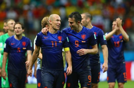 SALVADOR, BRAZIL - JUNE 13: Arjen Robben (L) and Robin van Persie of the Netherlands walk off the field after scoring two goals each and defeating Spain 5-1 during the 2014 FIFA World Cup Brazil Group B match between Spain and Netherlands at Arena Fonte Nova on June 13, 2014 in Salvador, Brazil.  (Photo by Quinn Rooney/Getty Images)