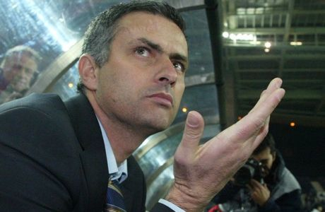 Chelsea?s coach Jose Mourinho asks photographers to stand back after they swarmed him after entering the pitch at the Dragao Stadium for the UEFA Champions League Group H match between FC Porto and Chelsea, Tuesday Dec. 07, 2004 in Porto, northern Portugal. (AP Photo/Paulo Duarte)