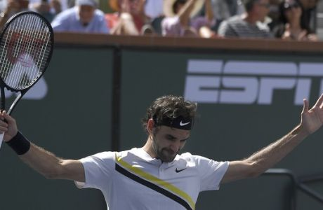 Roger Federer, of Switzerland, celebrates after beating Borna Coric, of Croatia, during the semifinals at the BNP Paribas Open tennis tournament, Saturday, March 17, 2018, in Indian Wells, Calif. (AP Photo/Mark J. Terrill)