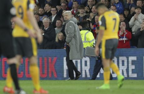 Arsenal manager Arsene Wenger looks back across the pitch as he leaves after losing the English Premier League soccer match between Crystal Palace and Arsenal at Selhurst Park in London, Monday April 10, 2017. (AP Photo/Tim Ireland)